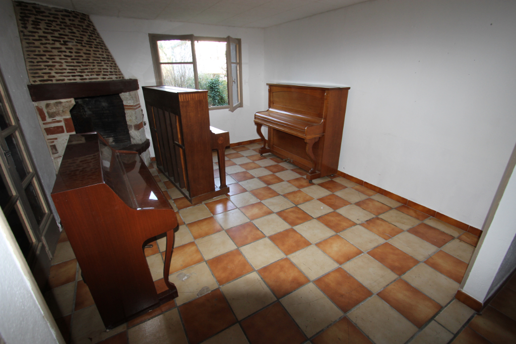 Local commerciale + appartement T2 9/11